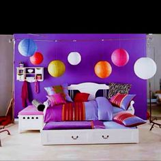 Cute teen room idea with the different round ceiling lights!  http://tlc.howstuffworks.com/home/teen-bedroom-decorating-ideas.htm