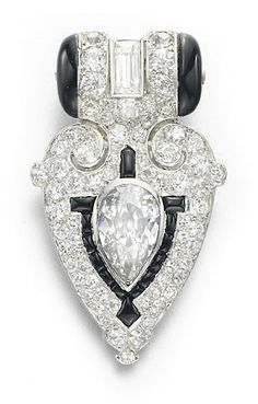 AN ART DECO DIAMOND AND ONYX DRESS CLIP, BY CARTIER