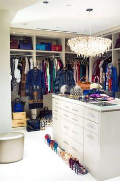 Hello, wonderful closet! I have always admired those with organized closets, especially when the closet is this big! I love the colorful row of heels, too.