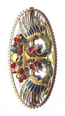 An art nouveau plique-à-jour enamel brooch, circa 1910.
