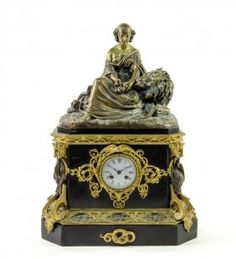 A NAPOLEON III GILT AND PATINATED BRONZE MOUNTED FIGURAL MANTEL CLOCK, AFTER EDOUARD QUESNEL French, late 19th century/early 20th century The mantel clock surmounted with a depiction of Aesop's fable The Lion in Love, the peasant's daughter cutting the nails of the lion above the rectangular case fitted with a circular enameled dial with Roman numeral dial, within a raven surmounted and ivy leaf scrolling border, flanked by bird and fish mounts