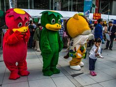 Still outside the big library in the western part of Asakusa, in Kappabashi, two kappa water sprites (mascots for the area) and Gunma-chan, the horse mascot of Gunma Prefecture pose with people who have gathered for the Kappabashi matsuri. #Asakusa, #Kappabashi, #kappa, #Gunma, #mascot October, 12 2015 © 2015 Grigoris A. Miliaresis Gunma, I Cool, Sprites, Kappa, Minions, Tokyo, The Outsiders, Disney Characters, Fictional Characters