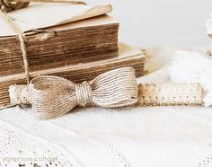 This is a petite tea-dyed headband  with a precious handmade  burlap bow ~  $8.95