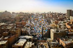 In his instantly recognizable, grandly sweeping style, eL Seed has painted Arabic calligraffiti murals everywhere from Tunisia to Paris, Dubai to New York. Recently, he created his most ambitious p…