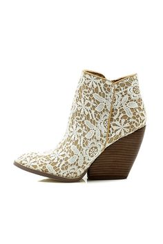 Lace ankle boot with wooden bootie. Wear with a white Boho dress for a casual chic look. Heel height is 4.25 inches. Love Me Lace Bootie by Very Volatile. Shoes - Booties Mississippi