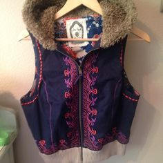 FREE PEOPLE RARE. Faux fur jacket vest. RARE. Never worn, pristine condition. This faux fur jacket vest is loaded with original details. From the intricate embroidery, Teddy bear faux fur and oriental inspired inside lining. Zipper front. Reasonable offers are welcome. If you love FP check out my closet!! Free People Jackets & Coats Vests