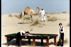 Stephen Hendry watches Steve Davis play a shot in the Dubai desert before both players took part in the Dubai Duty Free Classic snooker tournament in 1990. Ted Blackbrow / Daily Mail / Rex Features