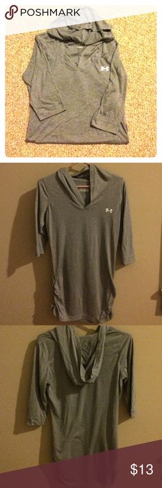 Under armour three quarter sleeve tunic Three quarter sleeved gray tunic with cinched sides at hip, worn once.... Great condition!!  Perfect for leggings! Under Armour Tops Tunics
