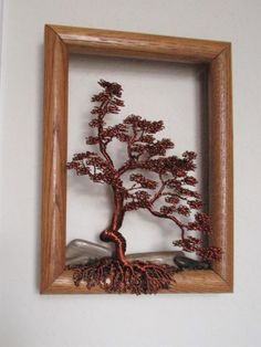This unique framed brown copper wire tree will draw attention hanging on your wall. The stones are a lovely accent. The frame measures 8 inches by 6 inches. Wire Bracelets, Wire Rings, Copper Bracelet, Beaded Rings, Wire Jewelry, Beaded Jewelry, Handmade Jewelry, Sculptures Sur Fil, Fantasy Wire