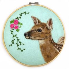 This beautiful large hoop-framed wool painting is accented with silk ribbon embroidery and would make a great statement on any wall or shelf. This listing is for one 8 hoop-framed wool painting. It features a fawn head/torso, on a mint background with silk ribbon embroidery accent.
