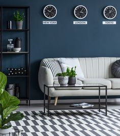 Stock Photo - Black table near beige sofa against navy blue wall with clocks in living room interior with plant Dark Blue Living Room, Beige Living Rooms, Blue Rooms, Living Room Interior, Room Wall Colors, Paint Colors For Living Room, Teal Bedroom Decor, Navy Blue Walls, Beige Sofa