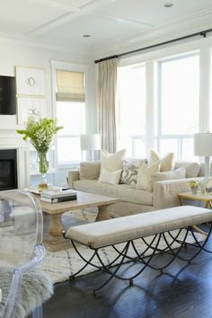large windows for natural light. soft hued neutrals. plenty of pillows. perfection.