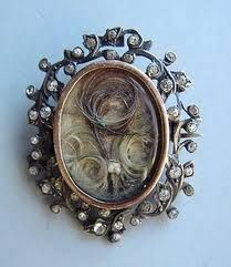 Hair art became popular in the Victorian age. What started as a simple way to keep a loved one near became an elaborate art practiced by many. Taking a lock of hair and weaving it into knot designs for use in a broach was the most popular form of Victorian mourning jewelry.