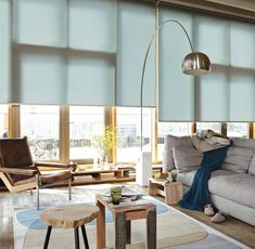 Scandi living room with a hint of colour the large windows are dressed with Rollershades.