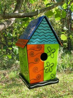 Hand-crafted backyard birdhouse by Ellilnwood Studios. This is made of glass panels over a functional wooden birdhouse. This is, indeed, beautiful.