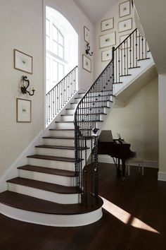 rod iron railing Staircase Traditional with arch window black banister framed wall art Black Stair Railing, Stairs Balusters, Black Stairs, Banisters, Rod Iron Railing, Wrought Iron Stair Railing, Iron Staircase, Staircase Design, Staircases