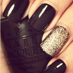Black with gold glitter accent finger nail polish design.