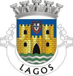Heráldica do Município de Lagos. Armas -  Escudo de azul, com pano de muralha de…