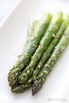 Roasted Asparagus ~ Quick and easy roasted asparagus recipe, with thick asparagus spears, olive oil, garlic, salt, pepper, and a little lemon juice. ~ SimplyRecipes.com