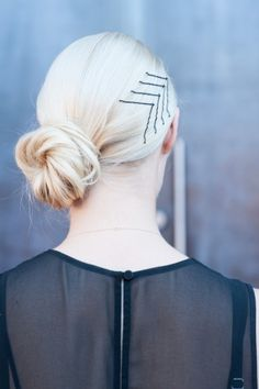 artful bobby pin placement. Light blonde hair.