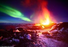 Two of my favorite natural wonders meet in Iceland - volcanic eruption with northern lights overhead