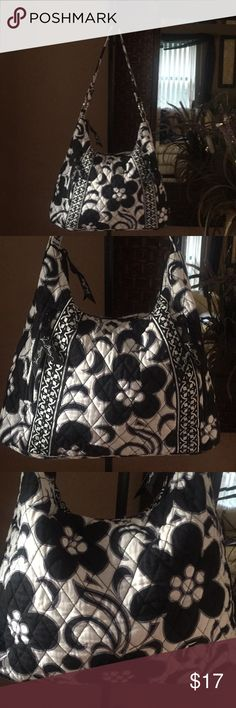 Vera Bradley Handbag A black and white handbag that measure about 10 inches from top to bottom and about 13 inches from side to side and strap drop about 11 inches no rips or tears or stains in good used condition. Vera Bradley Bags Shoulder Bags