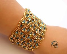 This bracelet made of golden Czech beads is very soft, smooth and light. It wraps the wrist so softly and pleasantly. Sparkling faceted bead...