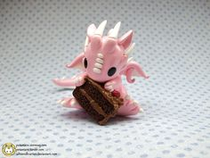 This pink dragon loves cake! by whitemilkcarton on deviantart