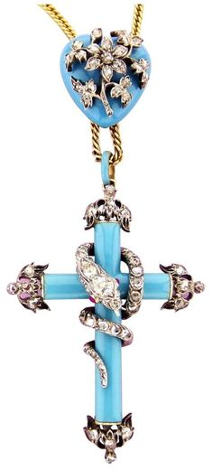Victorian Enamel Ruby Diamond Silver Gold Serpent Cross and Locket. A Victorian…