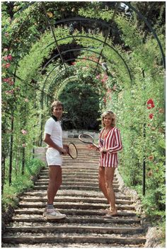 Jack and GeeGee Entz beneath the rose-canopied steps which lead to the entrance of the tennis courts at the Villa d'Este at Tivoli, near Rome, Italy, circa Photo Slim Aarons Slim Aarons, Marcello Mastroianni, Old Money, Thing 1, Attractive People, High Society, Hotel Decor, Mode Vintage, Vintage Italy