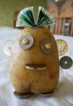 A fun way to give money as a present - moneypotato. (Norwegian coins have a hole in the middle!)