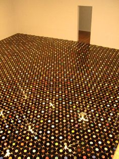 Here's a musical twist to the concrete and resin floor: using records! http://www.youtube.com/watch?v=B2T0G4Su5w8