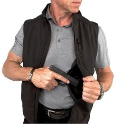 Vest is made with polyester, stretch, high density fabric that is breathable and water repellant. Extremely comfortable, practical and attractive. Makes a perfect layer and can be worn under larger outwear jackets. Concealed Carry Clothing, Concealed Carry Holsters, Gun Holster, Protection Rapprochée, 4 Way Stretch Fabric, Hunting Clothes, Undercover, Self Defense, Carry On