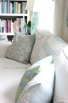 Style Secrets! Bookcases can be messy. Color coding your books is a great way to organize a bookcase with a decorator look.  Update neutral sofas with pillows in the color of the season  like these summery blues and whites.  Don't overlook these small details and achieve an effortless and stylish space.  Sponsored by HomeGoods.
