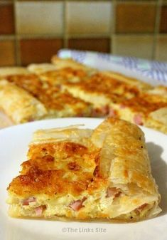 This is THE BEST recipe for a delicious Ham & Cheese Puff Pastry Quiche! It is s… This is THE BEST recipe for a delicious Ham & Cheese Puff Pastry Quiche! It is so versatile that it can be made… Continue Reading → Quiche Recipes, Egg Recipes, Brunch Recipes, Appetizer Recipes, Appetizer Dinner, Cooking Recipes, Breakfast Dishes, Breakfast Recipes, Gourmet