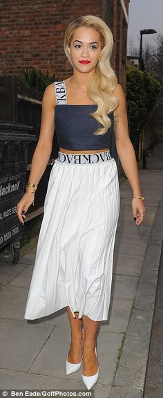 #partywear | Rita Ora in a blue crop top & white pleated midi skirt paired with white pumps