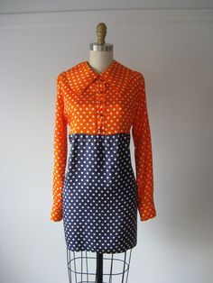 vintage 1960s mini dress / 60s maternity dress, $68.00. I had a mini dress in the exact same color/material combination, only it buttoned all the way down the front and had the red polka dot material hot pants to match! I thought I was so groovy in that outfit! Ha