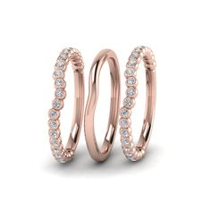 Curved Stackable Womens Wedding Bands with Diamonds in 14K Rose Gold exclusively styled by Fascinating Diamonds