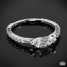18k white gold custom East-West Diamond Marquise engagement ring. This fairytale sweet design includes .50ctw in A Cut Above diamond melee and a gorgeous 0.86 ct H SI1 Marquise Diamond center stone