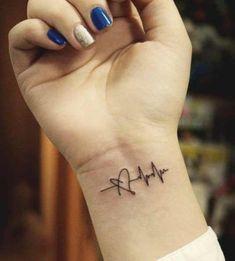 tattoos for women meaningful & tattoos for women ` tattoos for women small ` tattoos for moms with kids ` tattoos for guys ` tattoos with meaning ` tattoos for women meaningful ` tattoos on black women ` tattoos for daughters Meaningful Tattoos For Women, Wrist Tattoos For Women, Small Wrist Tattoos, Tattoo Small, Small Tattoos For Girls, Side Tattoos Women Small, Cross Tattoo On Wrist, Faith Tattoo On Wrist, Bird Tattoo Wrist