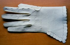 Alum tawed goat sin gloves with pinking and scaloped cuffs. Made for the Globe Theatre