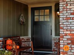 """Craftsman style 42"""" x 80"""" entry door with no shelf. Jeld-Wen Model A-362 Aurora fiberglass with Frosted glass toplight. Split finish - Factory painted black exterior and Eggshell interior. Emtek Wilshire oil rubbed bronze Hardware. Installed in Fullerton, CA home."""