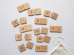 Explore numbers and digits with this innovative matching game for little hands! Features 24 wooden blocks consisting of numbers 1-12 and their coordinating quantity shown in domino-style dots. Children are challenged to sort through and correctly match numerals with their quantities. Fun for all ages, whether introducing just a few digits at a time for toddlers, or allowing older children to try and complete it in record time! Perfectly interlocking shapes make 12 satisfying number pairs for… Number Matching, Matching Games, Montessori Materials, Montessori Toys, Friends Font, Wooden Puzzles, Wooden Blocks, Wooden Numbers