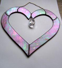 A beautiful pink heart glass suncatcher made by #etsy seller #phoenixfireglass
