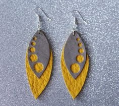 Gray and yellow leather earrings. The lenght of them is approximately 6 cms. Colors might appear slightly different on the screen than in real life. My creations come from a smoke and pet free environment.