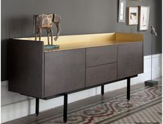 Punt Stockholm Sideboard finished with an amazing Gold Metal Top (http://www.cimmermann.co.uk/product/punt_mobles_stockholm_sideboard_low/)