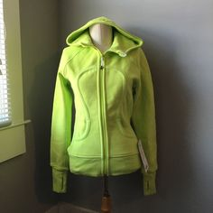 BNWT Lululemon Scuba Hoodie in Ray/White Super soft and cozy zip up hoodie in fluorescent yellow green color. By fluorescent, this one is super bright! White fleece inside, feels like wearing a hug. Brand new with tags, never been worn. It's a bit wrinkled from being stored but is in perfect condition otherwise. lululemon athletica Tops Sweatshirts & Hoodies