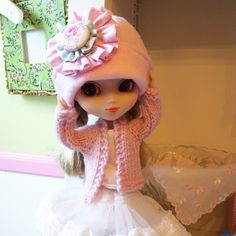 This 2 piece outfit for your Pullip doll is really sweet!! This sweet hat and hand knitted sweater set in pale pink will keep your precious girl warm on the fall and winter days. :) (It is starting to get really cold in the mountains so I am knitting again. :) The pale pink sweater made from a Cashmere blend yarn has a top button if you want to close it on colder days. :)) The hat is so cute with its big flower with a covered button in the middle. Your girl will look darling in this set and…