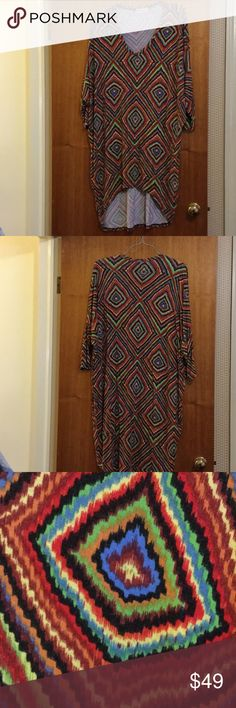 Long tunic top Long multicolor tunic style pull over top it's longer in the back then it is in the front as seen in the picture. It's from Zinzin of Dubai. All though I don't know the size of it. It could fit anywhere from a large to a size 18 maybe a little larger depending on how loose or tight fitting you like it. Three-quarter length sleeve. I have listed it as an estimated size 18 but it almost seems like a one-size-fits-all by the larger fit. zinzin Tops Tunics
