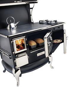 Fireview - fully functional wood burning cookstove with oven, warming oven, and optional propane gas burners.  Can also get a water jacket for a source of hot water.